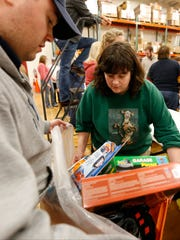 Volunteers pack bags for recipients of the Arctic League's