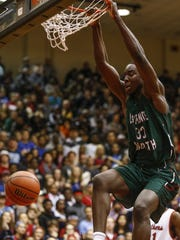 Lawrence North Wildcats Ra Kpedi (33) dunks against