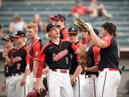 Rocori's Jack Steil is met by teammates during introduction before their game against New Ulm Friday, June 15, 2018, at Dick Siebert Field in Minneapolis.