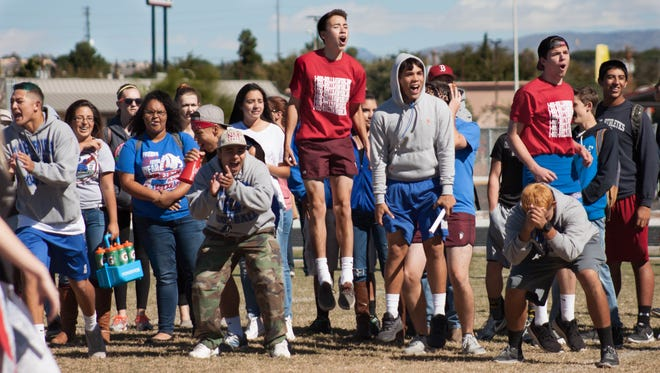 Las Cruces High School students cheer for classmates competing in a flag football game between the junior and senior classes during a pep rally on Thursday.