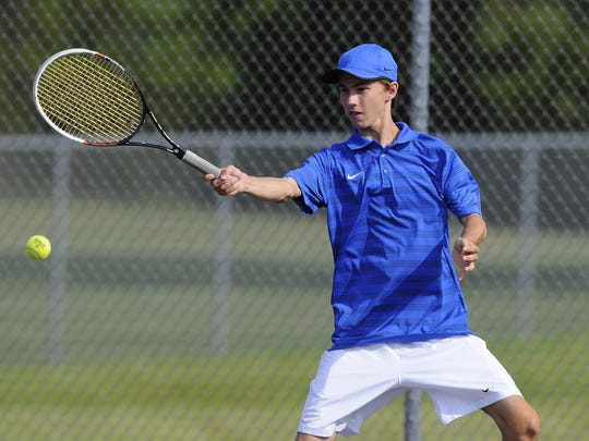 St. Clair's Seth Pinnoo hits a ball back to Marine City's Nic Flasher during their tennis match at the Blue Water Tennis Invitational at St. Clair High School.