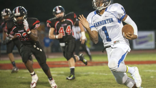 Hammonton quarterback Malachi Winters makes his way up field for a 45-yard gain in the first quarter of Friday's game.