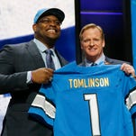 Duke offensive lineman Laken Tomlinson poses for photos with NFL commissioner Roger Goodell after being selected by the Detroit Lions as the 28th pick in the first round of the 2015 NFL draft.