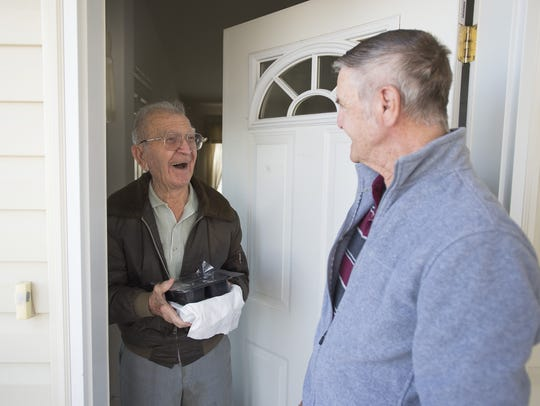 Gene Gentry delivers a meal through Meals on Wheels