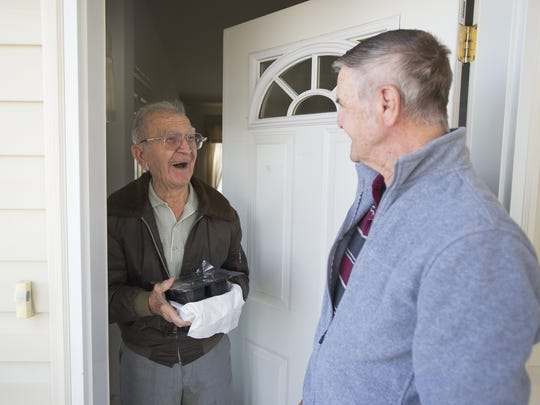 Gene Gentry delivers a meal through Meals on Wheels to John Mihalek, 97, at his home in east Fort Collins on Friday, March 17, 2017.