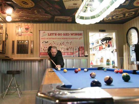 Brian Kelly shoots pool at the Hamburg Pub Thursday,
