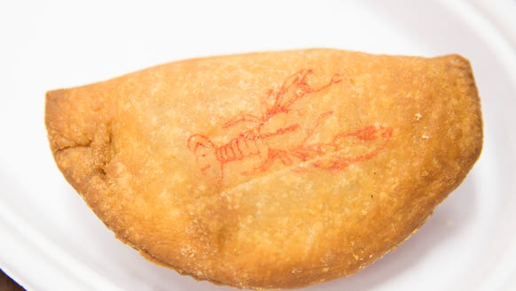 A crawfish eŽtouffŽe pie, with a stamp, at Cajun Works