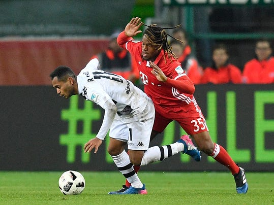 Moenchengladbach's Raffael, left, and Bayern's Renato Sanches challenge for the ball during the German Bundesliga soccer match between Borussia Moenchengladbach and Bayern Munich in Moenchengladbach, Germany, Sunday, March 19, 2017. (AP Photo/Martin Meissner)