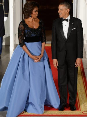 In her most recent dressed-up event, first lady Michelle Obama wore a Carolina Herrera ballgown with a full blue skirt and a black lace-overlay bodice for the state dinner for France in Feburary.