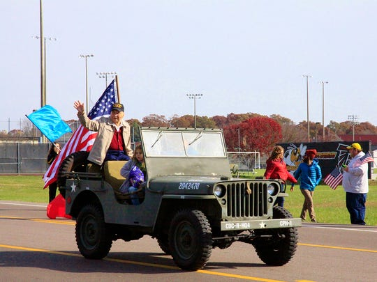 Fairview's John Stark, a WWII veteran, served as grand marshal for the community's first-ever Veterans Day Parade November 11, 2017.