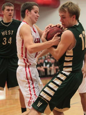City High's Evan Grace, left, fights for the ball with West High's Alex Henderson during their game at City High on Friday, Jan. 9, 2015.