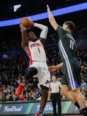 Pistons guard Reggie Jackson shoots against Warriors guard Klay Thompson during the first quarter Saturday at the Palace.
