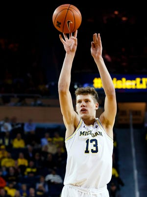Feb 16, 2017; Ann Arbor, MI, USA; Michigan Wolverines forward Moritz Wagner shoots in the first half against the Wisconsin Badgers at Crisler Center.