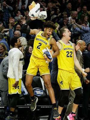 Michigan guard Jordan Poole (2)  and guard Duncan Robinson (22) celebrates from sideline during second half of U-M's 99-72 win over Texas A&M in the Sweet 16 of the NCAA tournament in Los Angeles on Thursday, March 22, 2018.