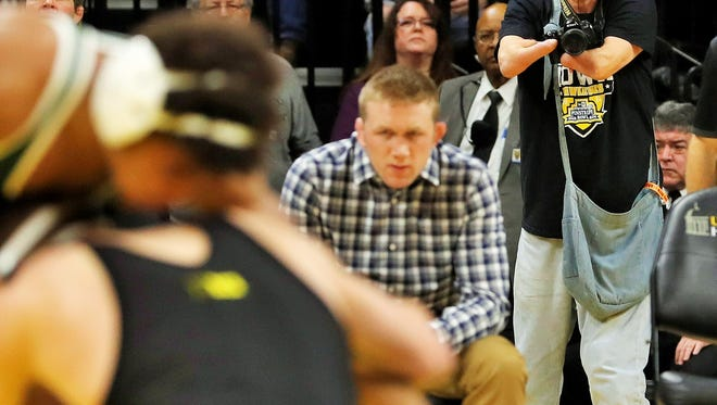 A lifelong and very knowledgeable Hawkeye fan, Don Lund's physical disability does not stop him from covering University of Iowa wrestling, football and basketball for the North Liberty Leader.