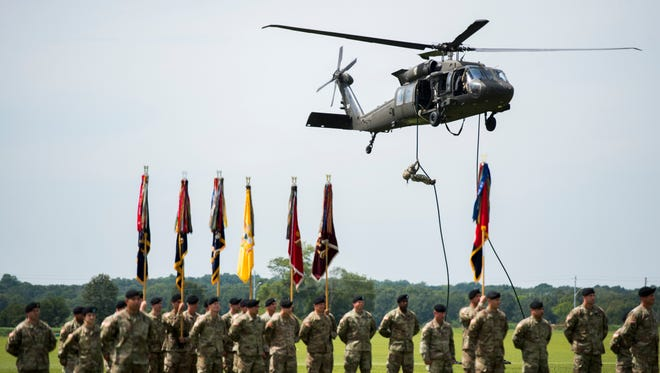 Soldiers stand at attention as the Air Assault demonstration begins from behind them on Aug. 25, 2017.