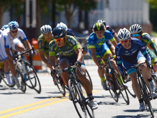 Racers make their way along Palafox Pl. during the Pro 1/2 race of the Subway Pensacola Cycling Classic in downtown Pensacola.