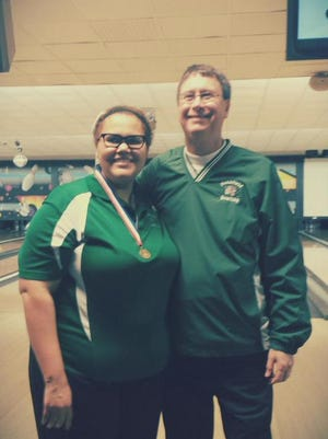 Pennfield senior Kadee Bechman and head coach Mike Roach pose following Bechman's Division 3 Singles State Championship at Airport Lanes in Jackson on Saturday.