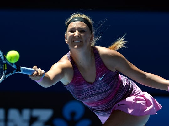 FILE - This is a Wednesday, Jan. 22, 2014 file photo of Victoria Azarenka from Belarus as she makes a forehand return to  Agnieszka Radwanska of Poland during their quarterfinal at the Australian Open tennis championship in Melbourne, Australia.  Former top-ranked Victoria Azarenka will return to competition next week at the Eastbourne grass-court tournament after a three-month layoff with a left foot injury. Tournament organizers say the Belarusian accepted a wild card entry Wednesday June 11, 2014  for the Wimbledon warmup event. (AP Photo/Andrew Brownbill, File)