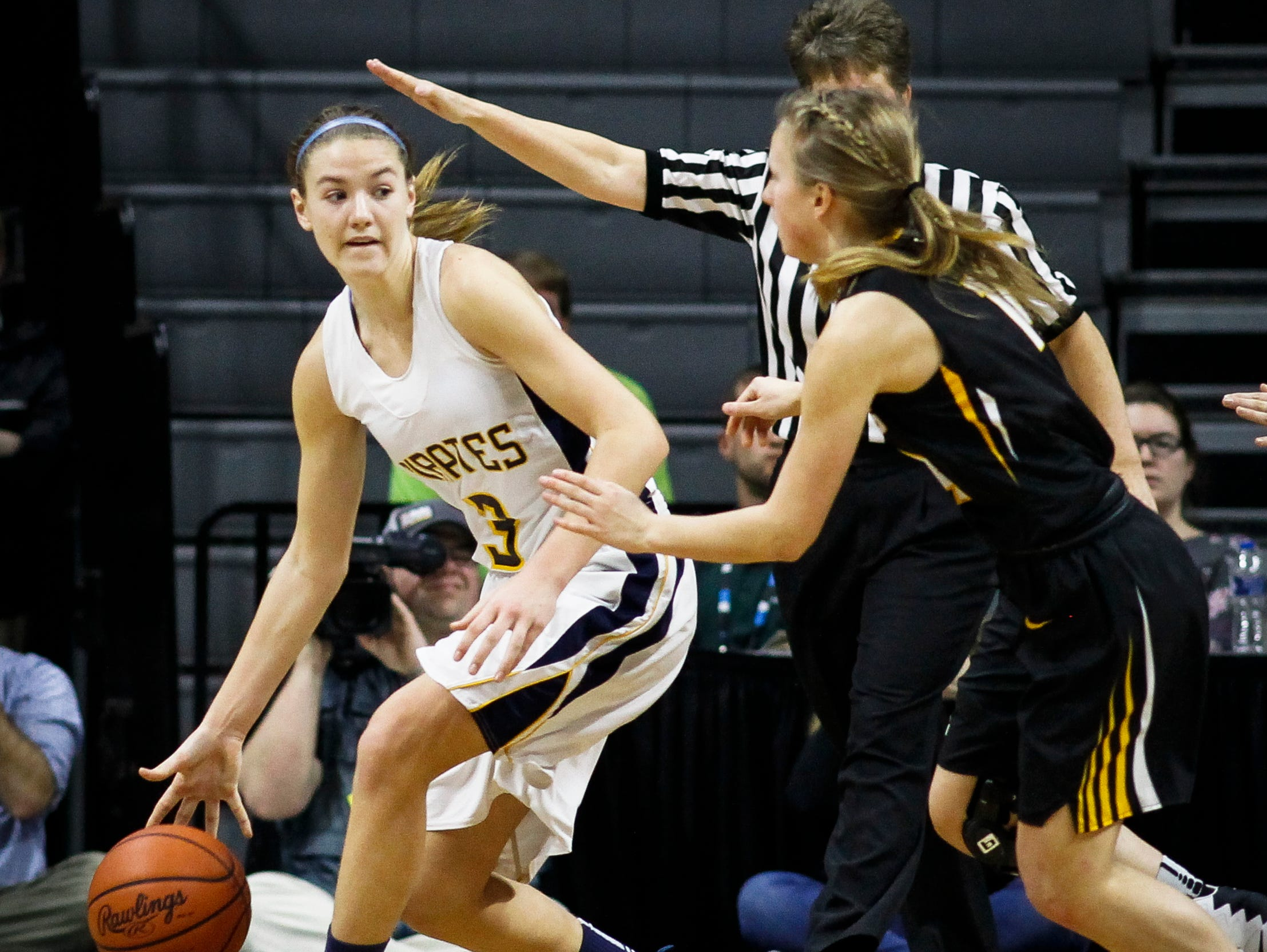 P-W's Hannah Spitzley staves off the Maple City Glen Lake defense Thursday, March 16, 2017, during the Class B Semifinal at the Breslin in East Lansing. P-W won 64-51.