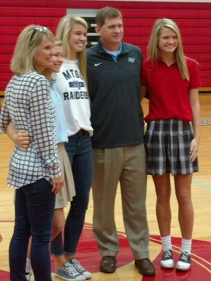 USJ's Anna Jones (center) poses with her family after signing her letter of intent.