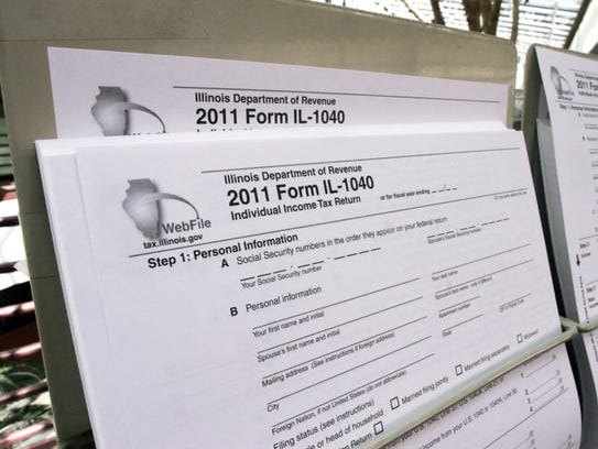 A 2011 1040 tax form along with other income tax forms
