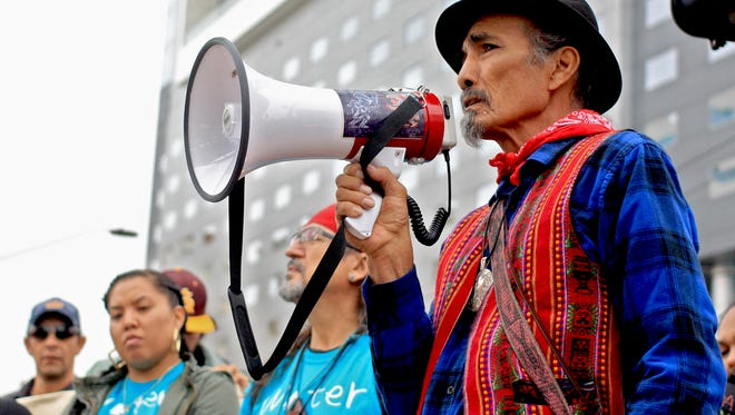 Protesters attending an anti-Dakota Access Pipeline demonstration  in downtown Phoenix shared stories of their experiences visiting the Standing Rock Native American Reservation in North Dakota.
