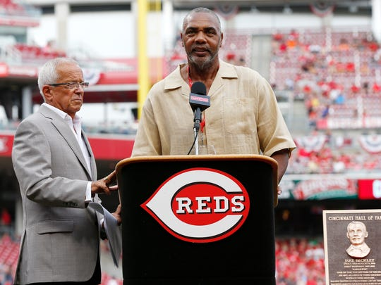 Reds Hall of Fame broadcaster Marty Brennaman stands with Reds Hall of Fame inductee Dave Parker during his induction ceremony in August of 2014.