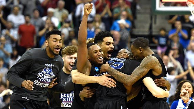 Teammates surround R.J. Hunter after Georgia State beat Baylor on Thursday.