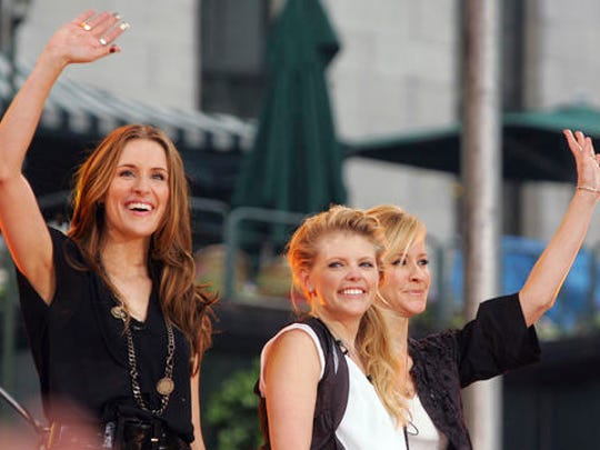 "FILE - In this May 26, 2006, file photo, Dixie Chicks, from left, Emily Robison, Natalie Maines and Martie Maguire, wave to the crowd as they perform on ABC's ""Good Morning America"" summer concert series in Bryant Park, in New York. The surprise collaboration of Beyonce and the Dixie Chicks at the Country Music Association Awards was still rocking the music world on Thursday, Nov. 3, 2016, but not all were impressed by the electric performance — and some country fans unleashed their anger on social media. Still, the collaboration did have plenty of fan support from others and celebrity admirers."