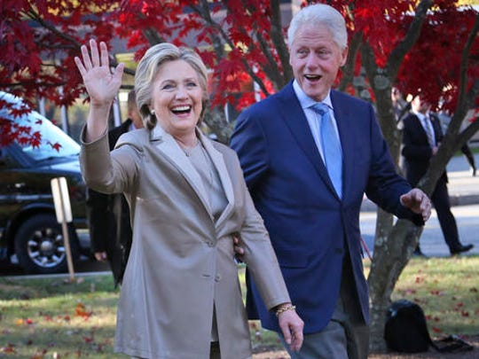 FILE - In this Nov. 8, 2016 file photo, Hillary Clinton and her husband, former President Bill Clinton, greet supporters after voting in Chappaqua, N.Y. Falling in line with tradition, Bill and Hillary Clinton plan to attend Donald Trump's inauguration. It's a decision that will put Hillary Clinton on the inaugural platform as her bitter rival from the 2016 campaign assumes the office she long sought.