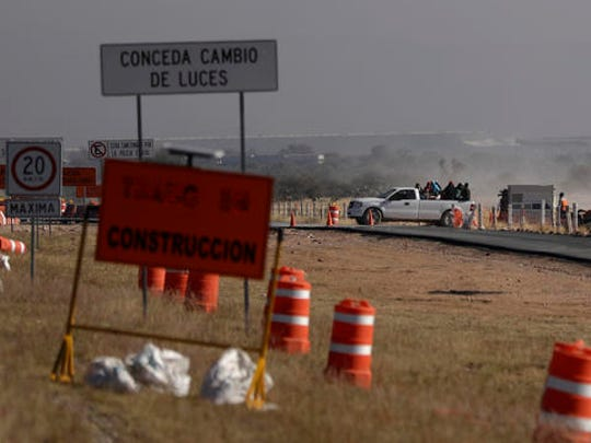 Workers leave the Ford construction site after they were sent home early the day after the U.S. auto company cancelled plans to build its plant in Villa de Reyes, outside San Luis Potosi, Mexico, Wednesday, Jan. 4, 2017.  An average worker in Mexico costs automakers $8 an hour, including wages and benefits, compared to the $60 an hour that Ford said it was spending on an auto worker in the U.S. at the end of 2015.
