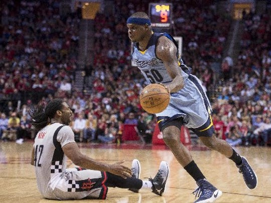 Jan 13, 2017: Memphis Grizzlies forward Zach Randolph (50) drives to the basket past Houston Rockets center Nene Hilario (42) during the second half at the Toyota Center. The Grizzlies defeat the Rockets 110-105.