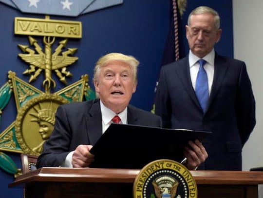 President Donald Trump, left, with Defense Secretary