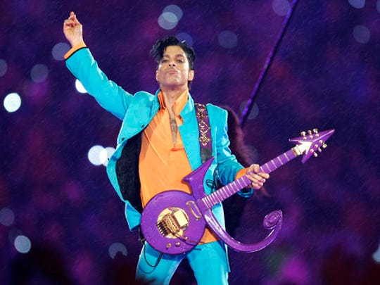FILE - In this Feb. 4, 2007, file photo, Prince performs during the halftime show at the Super Bowl XLI football game in Miami. Nearly a year after Prince died from an accidental drug overdose in his suburban Minneapolis studio and estate, investigators still haven't interviewed a key associate nor asked a grand jury to investigate potential criminal charges, according to an official with knowledge of the investigation.