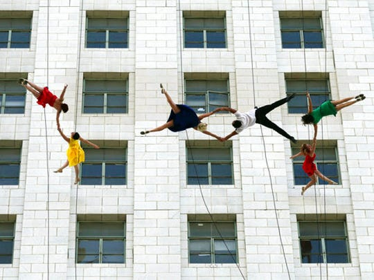 """Dancers from Bandaloop aerial dance troupe perform to a medley of songs and dances from the movie """"La La Land"""" off the side of Los Angeles City Hall, during """"La La Land Day"""" festivities Tuesday, April 25, 2017. Mayor Eric Garcetti proclaimed the honor for the musical that claimed six Academy Awards in February."""