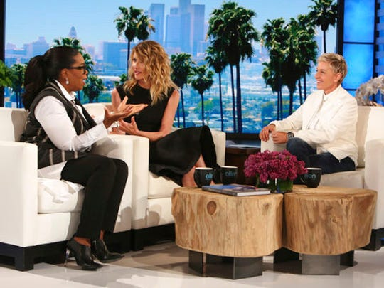 """In this April 5, 2017 photo released by Warner Bros., Oprah Winfrey, left, and Laura Dern appear with host Ellen DeGeneres at a taping of """"The Ellen DeGeneres Show"""" in Burbank, Calif. Twenty years ago Winfrey and Dern guest-starred with DeGeneres in an episode of her comedy series """"Ellen,"""" where she declared she was gay. The anniversary show will air on Friday."""