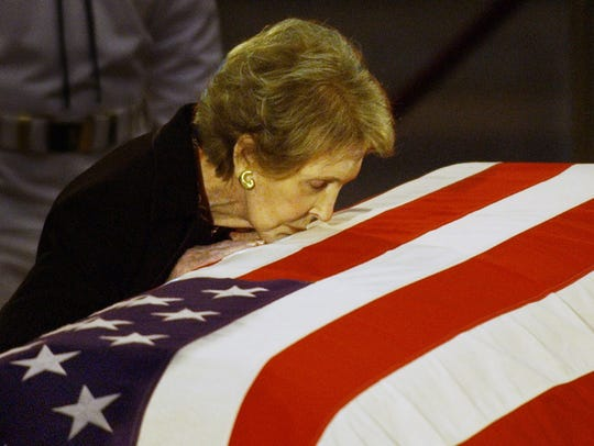 Reagan kisses the casket of her husband prior to the