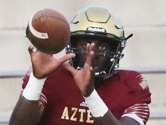 El Dorado wide receiver Tyquez Hampton catches a pass during the team's scrimmage game Wednesday at the Socorro Activities Complex.