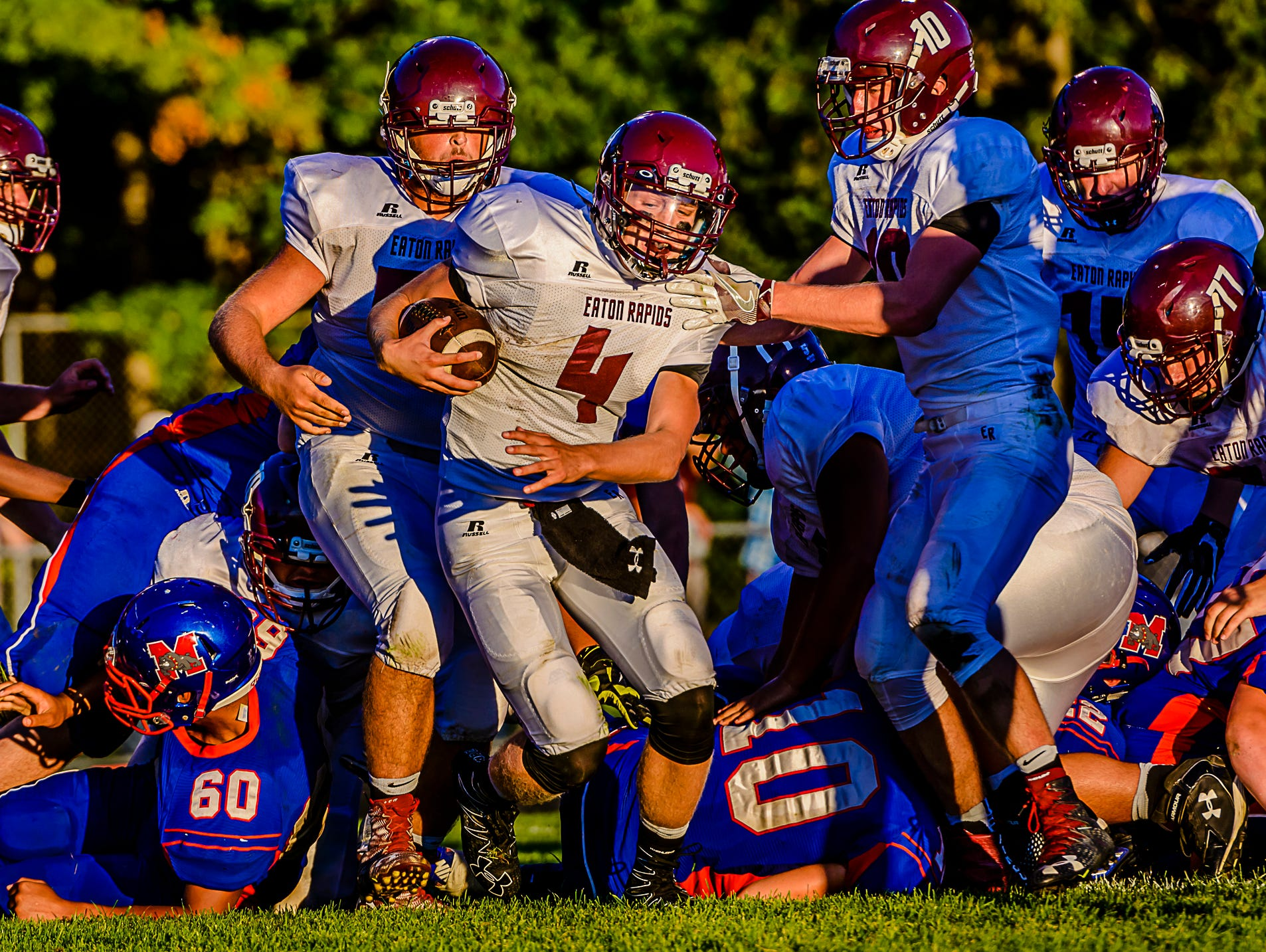 Eaton Rapids quarterback Zach Kemp ,4, burts through a hole in the Mason line to score a touchdown with 6:14 remaining in the 2nd quarter of their game Thursday September 1, 2016 in Mason. Mason and Eaton Rapids would go into the half tied 7-7. KEVIN W. FOWLER PHOTO