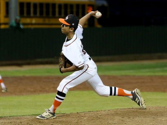 Burkburnett's Jacob Acheson pitches against Iowa Park
