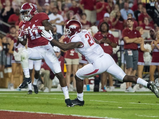 Alabama wide receiver Henry Ruggs III (11) makes a