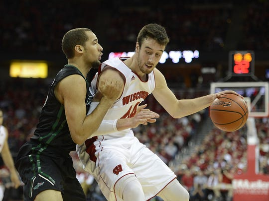 Wisconsin's Frank Kaminsky (44) tries to get around UW-Green Bay's Kenneth Lowe (45) in the first had during Wednesday night's game at the Kohl Center in Madison.