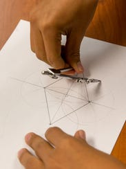 Student Natanii Yazzie uses a compass during a math