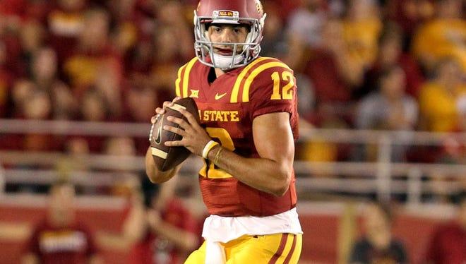 Iowa State Cyclones quarterback Sam B. Richardson (12) looks to pass against the Baylor Bears at Jack Trice Stadium.