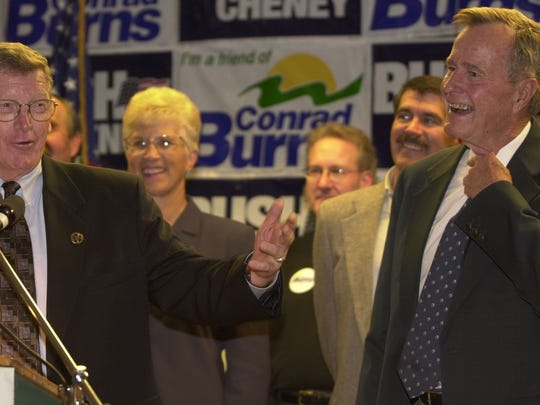Sen. Conrad Burns, left, and former president George H.W. Bush share a joke Saturday afternoon, Nov. 4, 2000, at a campaign rally at the Heritage Inn in Great Falls.