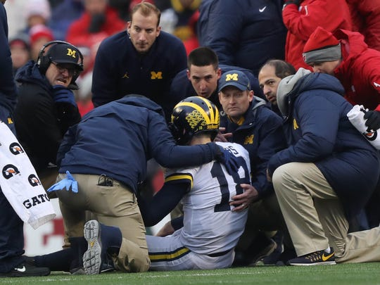 Michigan head coach Jim Harbaugh looks on as Brandon Peters is checked after being hit during the third quarter Saturday, Nov. 18, 2017, at Camp Randall Stadium in Madison, Wis.