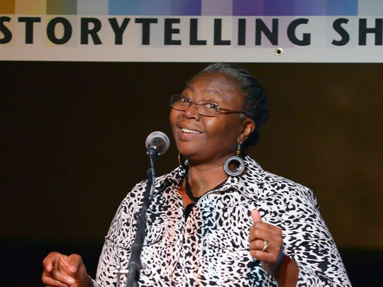 Rose Miller, a motivational speaker and Battle Creek resident, opens the Mosaic Storytelling Showcase at the Warehouse Tuesday night.