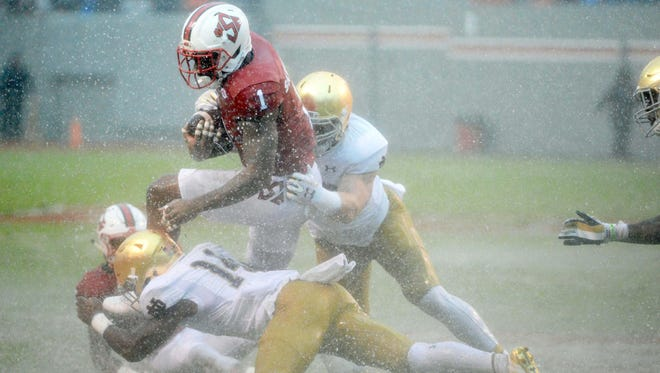 North Carolina State and Notre Dame played Saturday in a downpour from Hurricane Matthew.