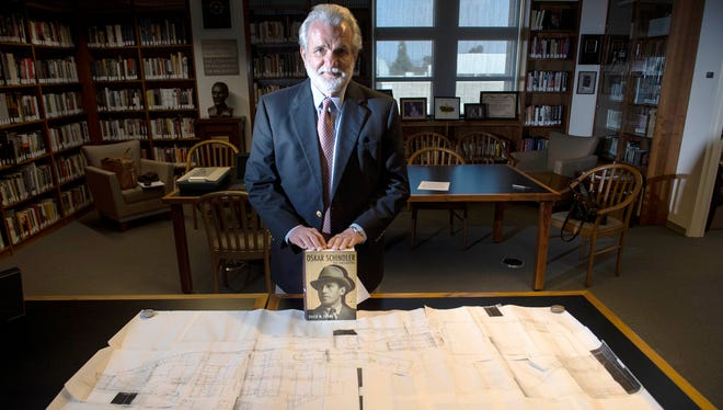 Author David Crowe shows his book and some of his archive collections at Chapman University on Wednesday, Oct. 12, 2016 in Orange, Calif. He donated his Oskar Schindler archive collections to Chapman University.